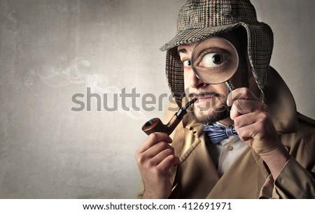 Retro dressed detective - stock photo