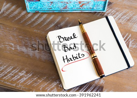 Retro effect and toned image of a fountain pen on a notebook. Handwritten text Break Bad Habits as business concept image - stock photo