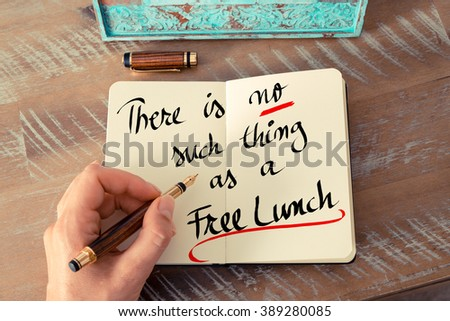 Retro effect and toned image of a woman hand writing a note with a fountain pen on a notebook. Handwritten text There Is No Such Thing As A Free Lunch as business concept image - stock photo