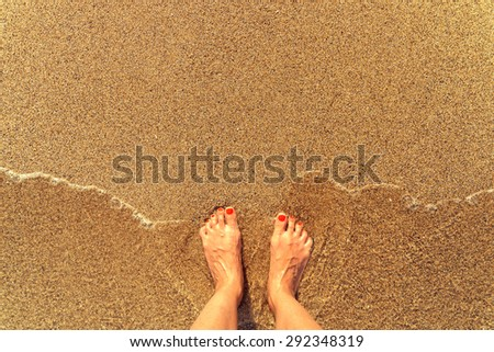 Retro Effect Of Sea Waves And Girl Feet On Summer Sand Beach - stock photo