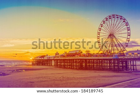 Retro Effect Photo Filter: Blackpool Central Pier and Ferris Wheel, Lancashire, England, UK - stock photo