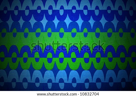Retro fabric from the 60's with a colorful op-art design, vignetted. - stock photo