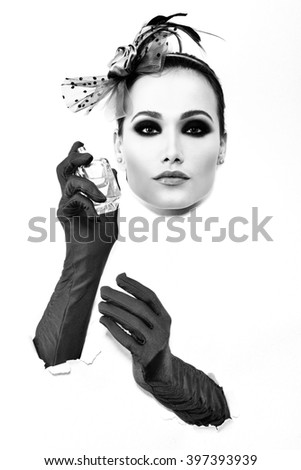 Retro fashion portrait of young woman with gloves and bottle of perfume, black and white. - stock photo
