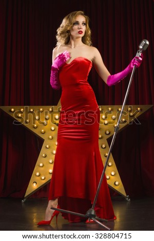 Retro female singer sing holding vintage microphone