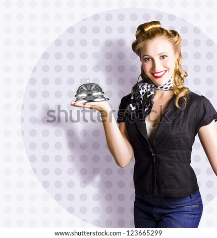 Retro Female Waiter At Your Service With A Well Dressed Woman Holding Massive Concierge Bell - stock photo