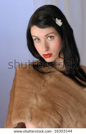 Retro fifties pin-up attractive girl in fur wrap on colorful background - pin-up concept - stock photo