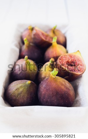 Retro Figs in a tray, selective focus - stock photo