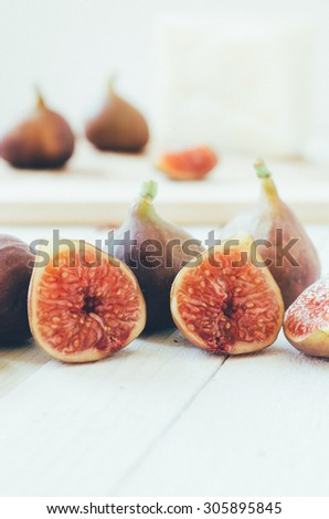 Retro Figs on white wooden boards, selective focus - stock photo