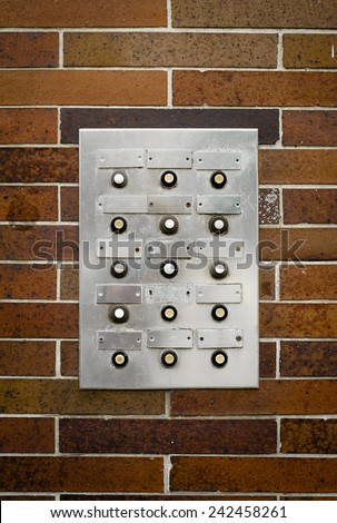 Retro Filter Photo Of Grungy Old Apartment Intercom Or Buzzer Against Brick Wall - stock photo