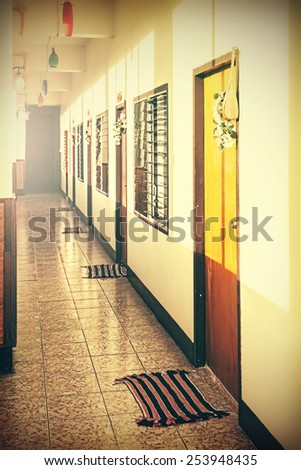 Retro filtered and faded picture of an empty desolated motel. Abandoned place concept. - stock photo