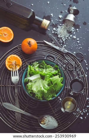 Retro Filtered Image: Lettuce Salad with Mandarin Oranges and Basic Dressing Ingredients - stock photo