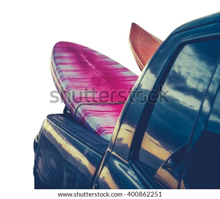 Retro Filtered Isolated Surfboards In A Truck At Sunset In Hawaii - stock photo