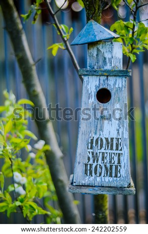 Retro Filtered Rustic Bird House With Home Sweet Home Printed On Peeling Paint - stock photo