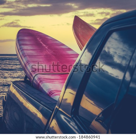 Retro Filtered Style Surfboards In A Truck At Sunset In Hawaii - stock photo