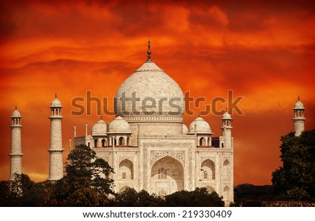 Retro filtered sunset over Taj Mahal, India. - stock photo