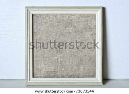 Retro frame with blank canvas inside for painting - stock photo