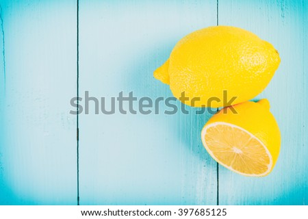 Retro Fresh Yellow Lemons On Wooden Table - stock photo