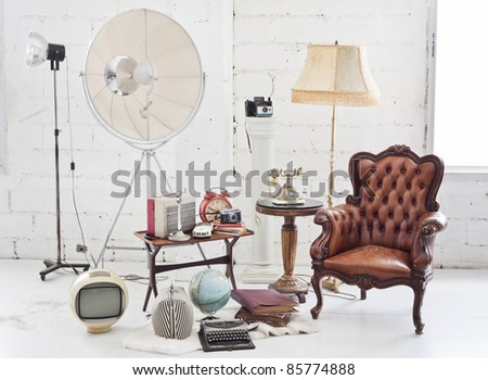 retro furniture and decoration in white room - stock photo