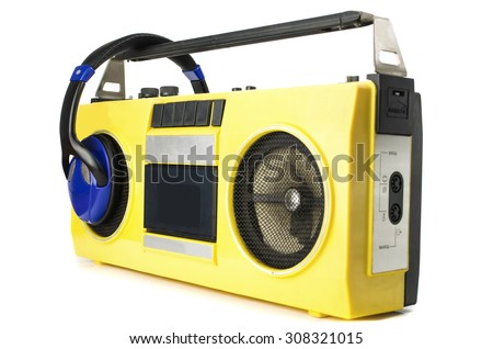 Retro ghetto blaster yellow with headphones, isolated on white with clipping path - stock photo
