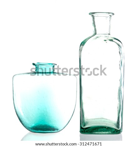 retro green glass bottle and vase on white background