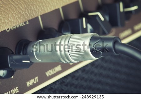 retro guitar amplifier control panel with jack - stock photo