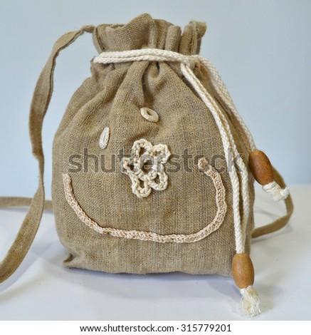 Retro handmade natural flax purse - stock photo
