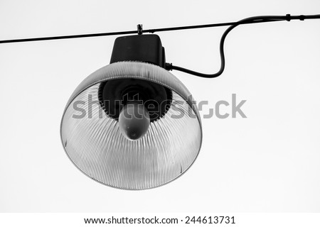 Retro hanging street lamp. Isolated on white. Black and white photo. - stock photo