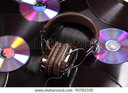 Retro headphones and vinyl records and cd - stock photo