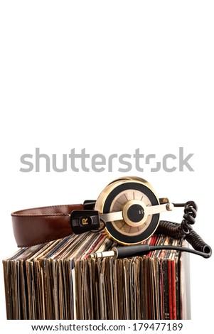 Retro headphones for professional audio with vintage vinyl records. - stock photo