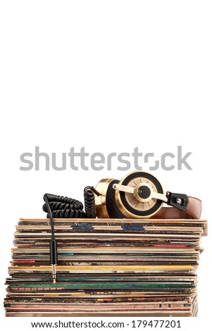 Retro headphones for professional audio with vintage vinyl records. - stock photo