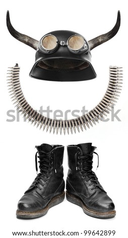 Retro helmet with bull long horns and other essential equipment for bikers. - stock photo
