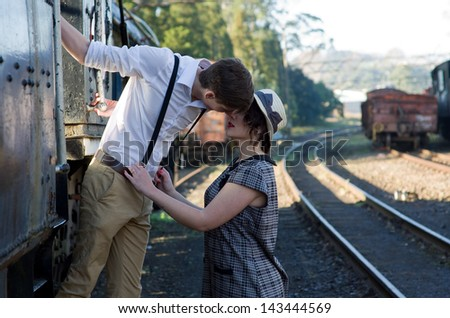 Retro hip hipster romantic love couple in vintage train setting - stock photo