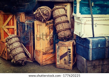 Retro hipster style travel image of vintage luggage and crates - stock photo