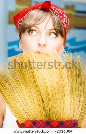 Retro Housewife Woman Looks To The Home Ceiling Cobwebs While Holding A Vintage Sweeping Broom In Classic House Wife Portrait - stock photo