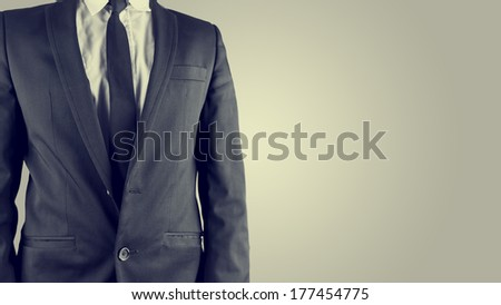Retro image of a businessman in a classic stylish linen suit with a white shirt and necktie, isolated torso view with copyspace. - stock photo