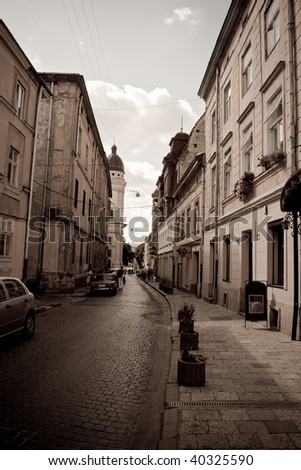 retro image of ancient old street. Lvov, Ukraine - stock photo
