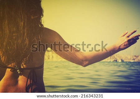 Retro image of girl in the sea - stock photo