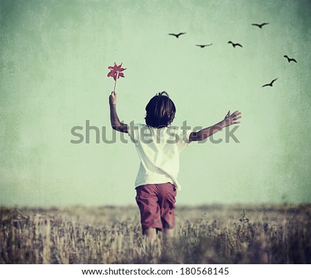 Retro image of happy cheerful carefree kid in nature - stock photo