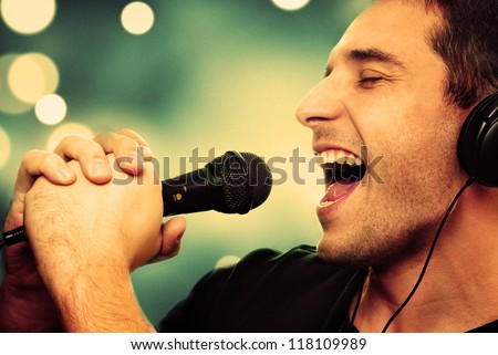 Retro image of man singing into microphone - stock photo
