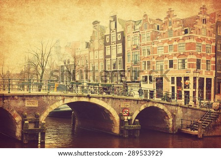 Retro image of Prinsengracht Canal, Amsterdam, The Netherlands.  Added paper texture. Toned image - stock photo