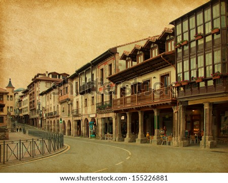 Retro image of street in Potes, Cantabria, Spain. Added papper texture