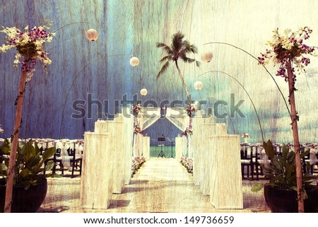 Retro image of Wedding setting on the beach with wooden texture , Vintage