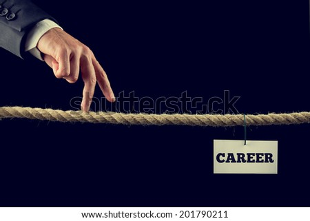 Retro instagram style image of a businessman walking his fingers along a length of rope or a tightrope towards his successful career. - stock photo