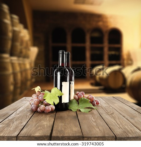retro interior of vintage barrels and wine on table  - stock photo