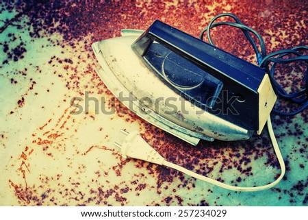 Retro Iron on rusty vintage background - stock photo