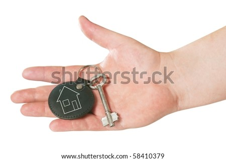 retro key in the hand isolated with clipping path