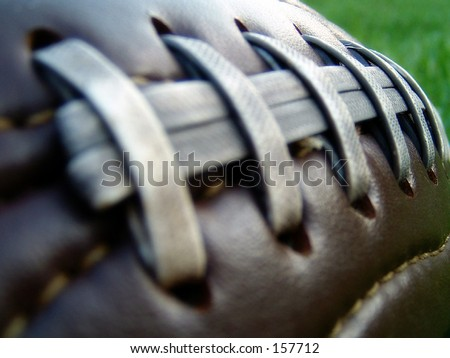 Retro leather football on grass field