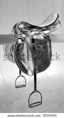 Retro look of horse saddle painted in silver - stock photo