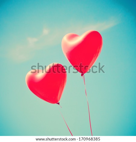 Retro love balloons on blue sky - stock photo