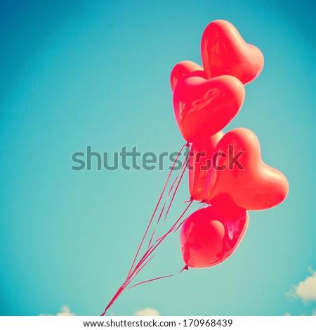 Retro love balloons on blue sky - stock photo